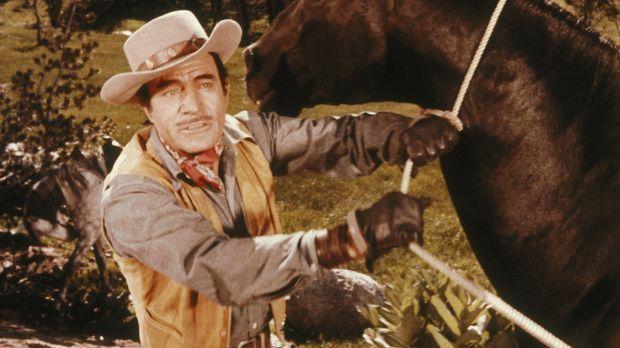 Pferdenarr Jim Acton (Gilbert Roland) muss aufgrund eines Gerichtsurteils sei...
