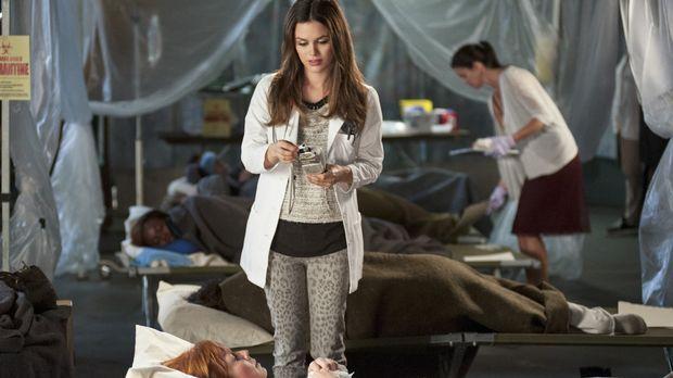 Während Zoe (Rachel Bilson) versucht die Grippeepidemie einzudämmen, muss Wad...